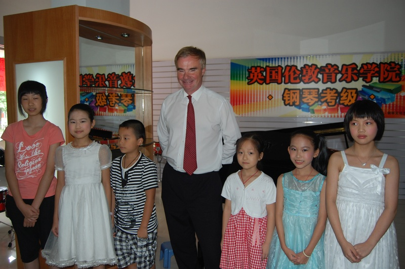 Christopher with pupils from a a new LCM music centre, Jiang Men, China